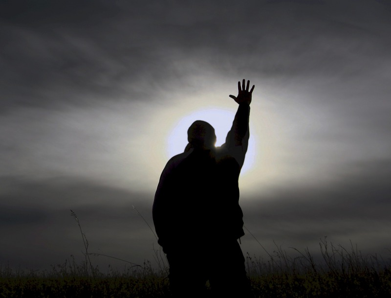 s_man-praying-elsewhereness